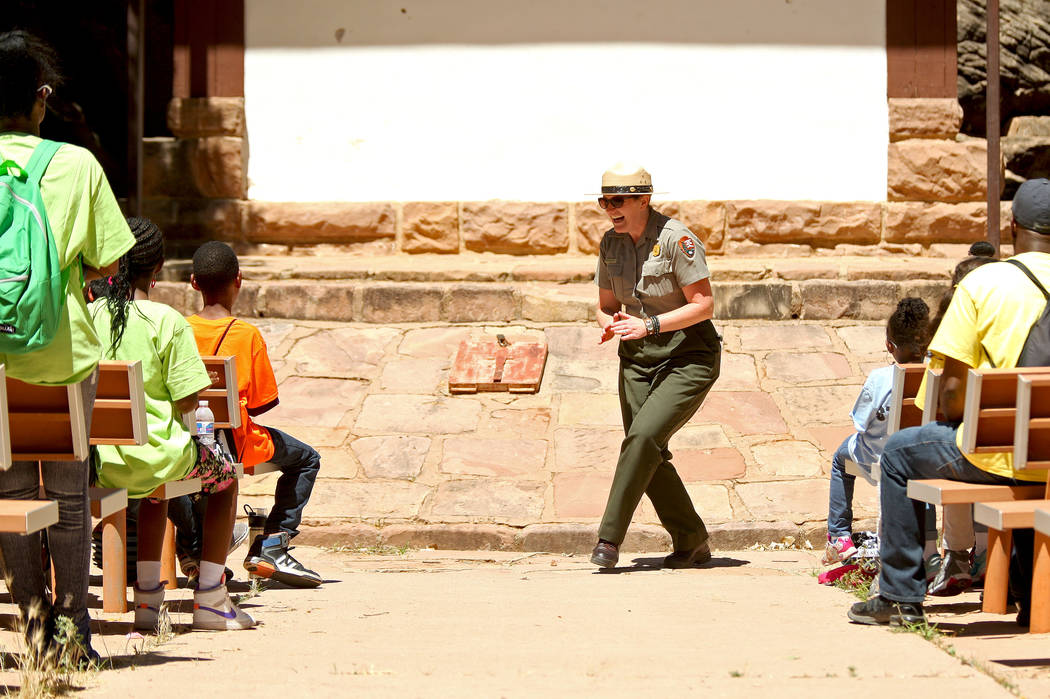 "Park Ranger Gretchen Weiss leads the kids and chaperones in a song at Zion National Park during the ""1 Million African American Youth In A Park"", Saturday, June 10, 2017. One hun ..."