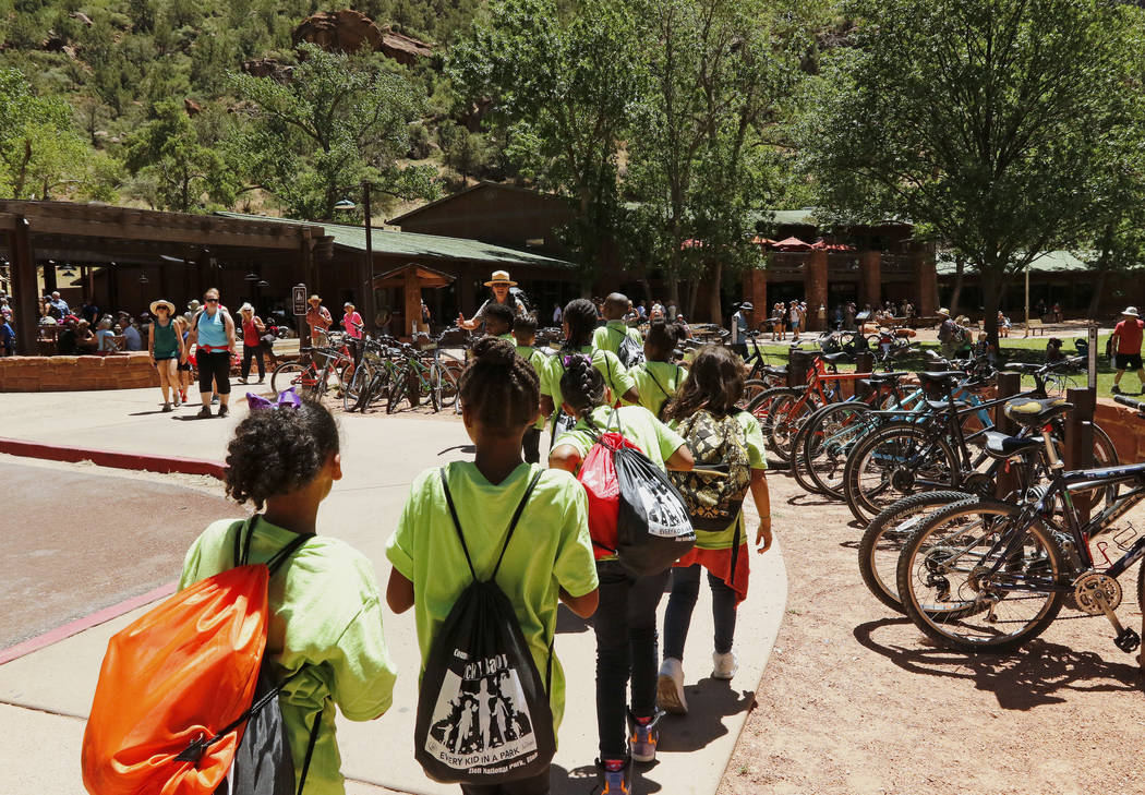 "Students from Kermit R. Booker and Matt Kelly Elementary Schools line up in front of the lodge at Zion National Park during the ""1 Million African American Youth In A Park"", Satu ..."