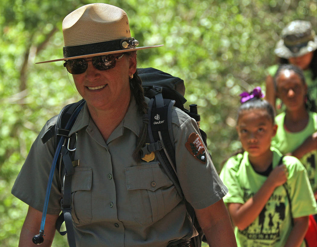 "Park Ranger Cinda Doughty guides her group on the Emerald Pools hike at Zion National Park during the ""1 Million African American Youth In A Park"", Saturday, June 10, 2017. One h ..."
