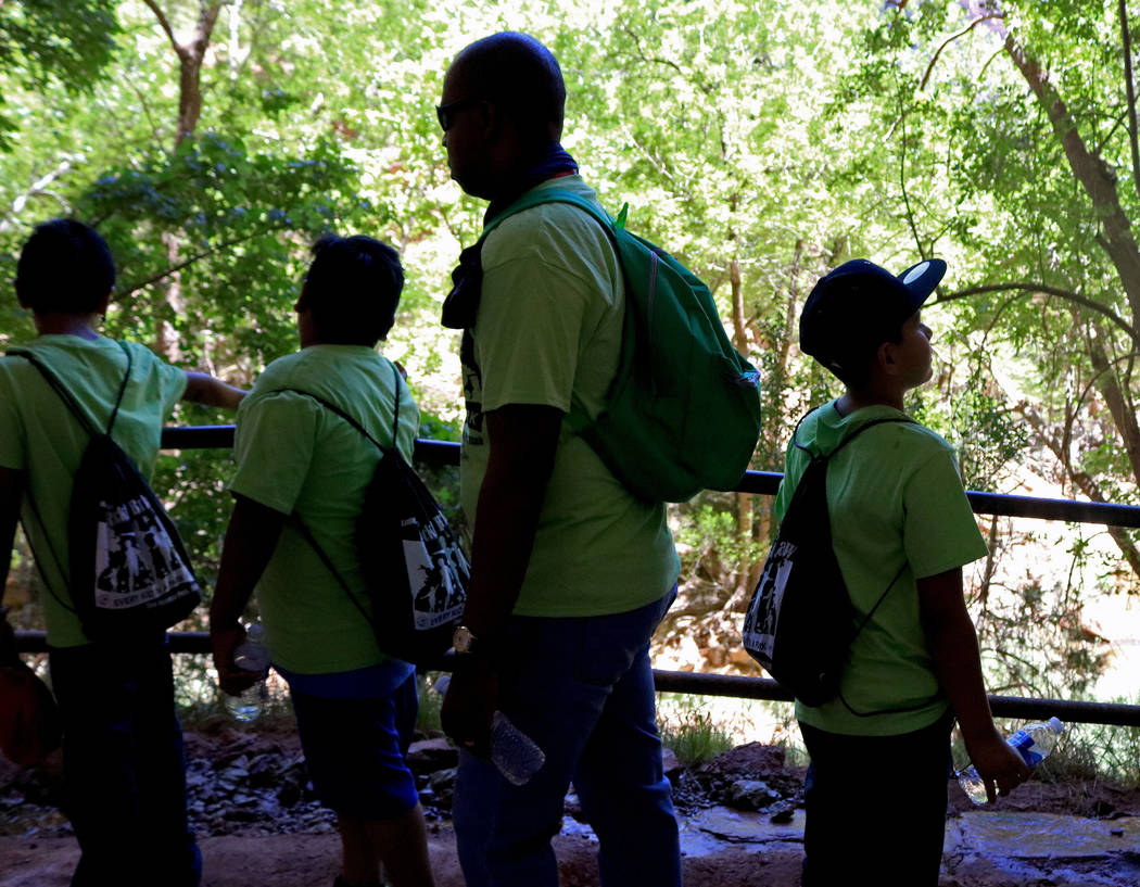"Students and chaperones enjoy the view on the Emerald Pools hike at Zion National Park during the ""1 Million African American Youth In A Park"", Saturday, June 10, 2017. One hundr ..."