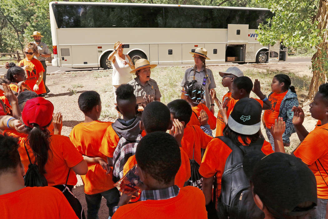 "Park Ranger Andi Buttram conducts the Junior Ranger oath at Zion National Park during the ""1 Million African American Youth In A Park"" program, Saturday, June 10, 2017. One hundr ..."