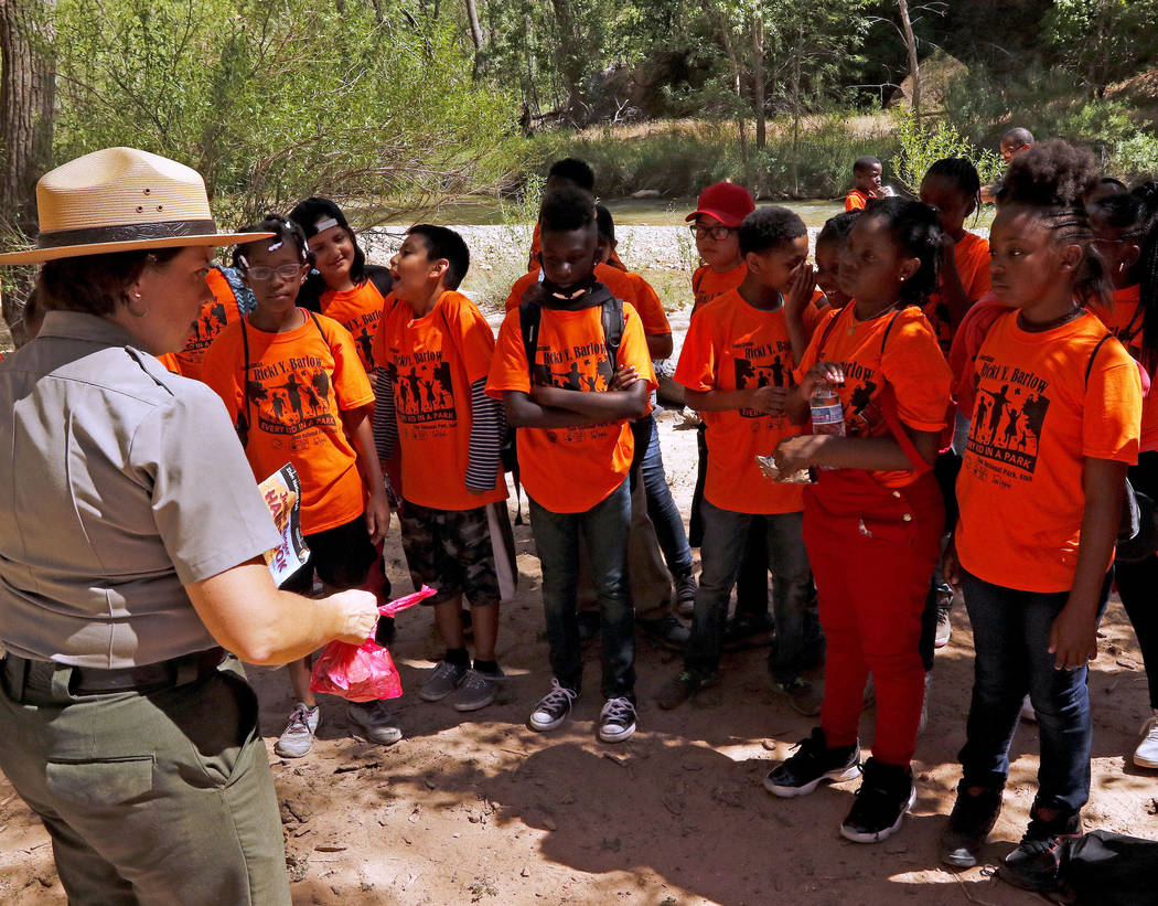 "Park Ranger Andi Buttram explains what it means to be a junior ranger to her group at Zion National Park during the ""1 Million African American Youth In A Park"" program, Saturday ..."