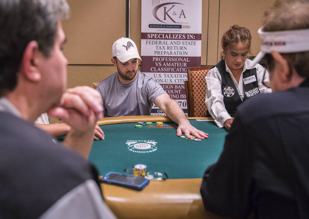 Joe Cada, middle, plays a hand during the World Series of Poker on Saturday, June 10, 2017, at the Rio hotel-casino, in Las Vegas. Benjamin Hager Las Vegas Review-Journal @benjaminhphoto