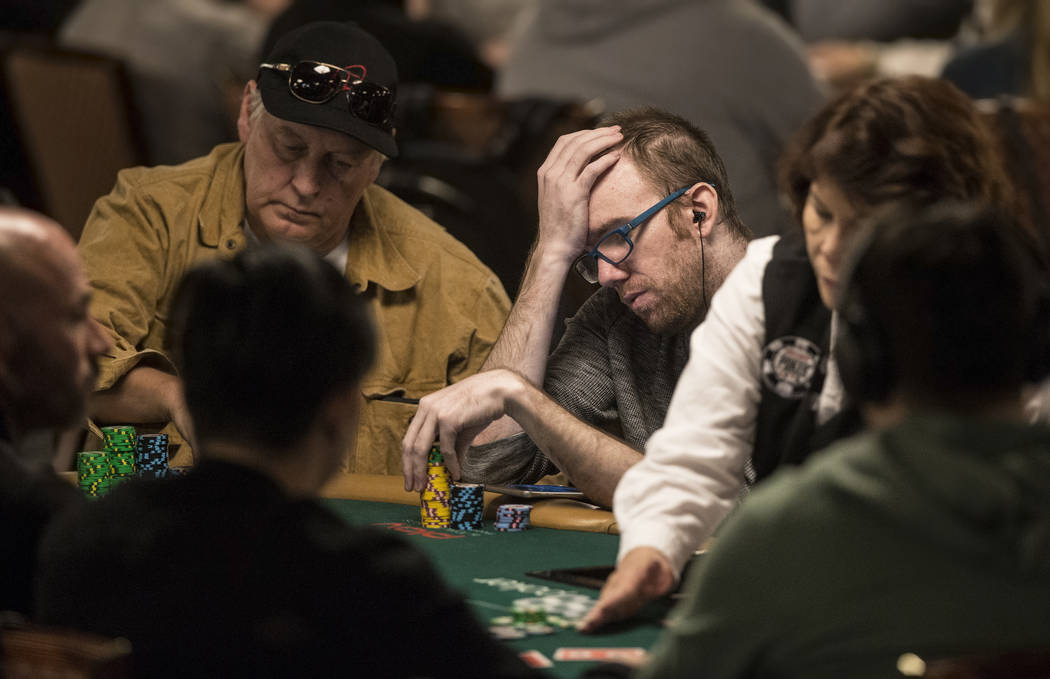 Tom Kearney, middle/right, plays a hand during the World Series of Poker on Saturday, June 10, 2017, at the Rio hotel-casino, in Las Vegas. Benjamin Hager Las Vegas Review-Journal @benjaminhphoto