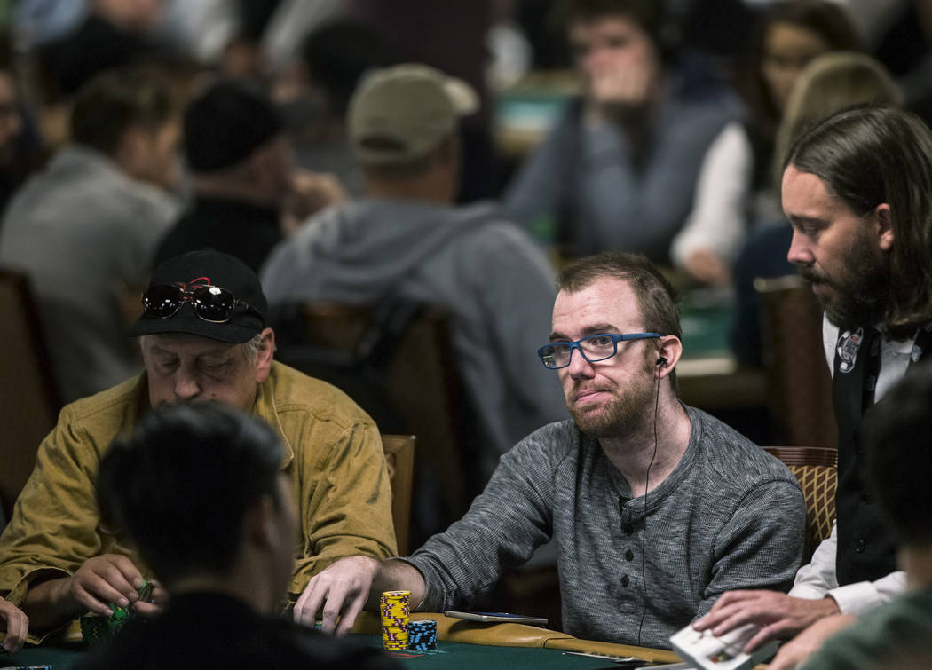 Tom Kearney, middle, plays a hand during the World Series of Poker on Saturday, June 10, 2017, at the Rio hotel-casino, in Las Vegas. Benjamin Hager Las Vegas Review-Journal @benjaminhphoto