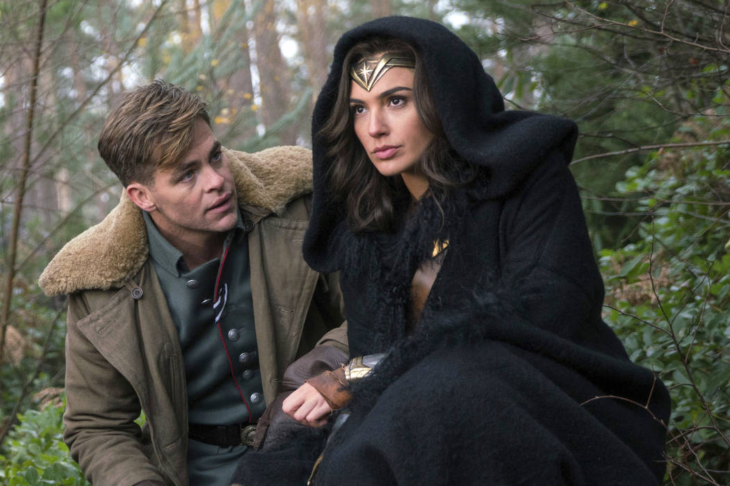 "This image released by Warner Bros. Pictures shows Chris Pine, left, and Gal Gadot in a scene from, ""Wonder Woman."" (Clay Enos/Warner Bros. Pictures via AP)"