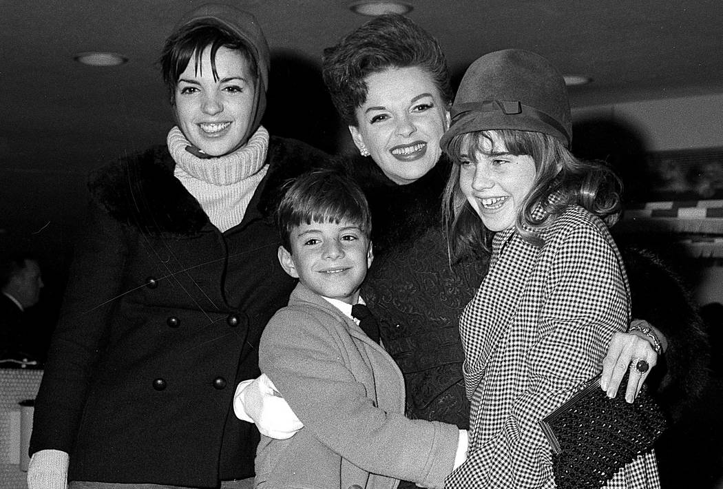 Singer-actress Judy Garland greets her son Joseph, 9, and daughter Lorna, 12, after they arrive from California at New York's Kennedy International Airport in New York on Dec. 29, 1964. Garland's  ...