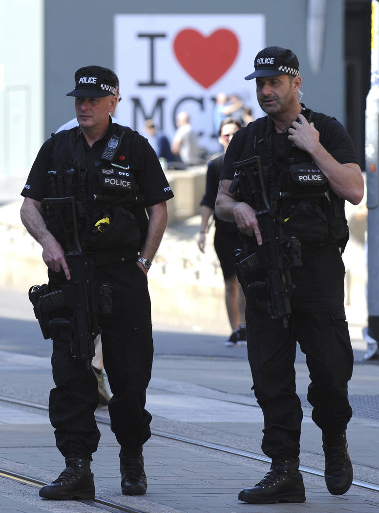 Armed police patrol the streets in central Manchester, England, on Thursday May 25, 2017. British police said Sunday, June 11, 2017, everyone arrested over the Manchester concert bombing has been  ...