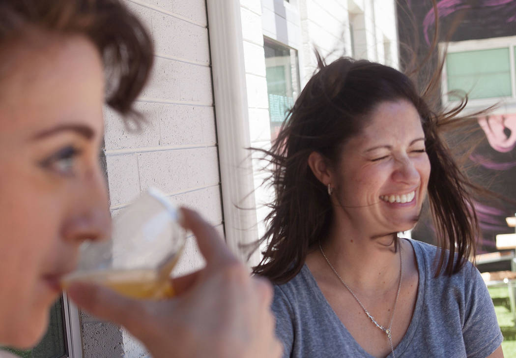 Carly Pasquale, left, and Lisa Laurance enjoy drinks together despite the wind behind Carson's Kitchen on Sunday, June 11, 2017, in Las Vegas. Rachel Aston Las Vegas Review-Journal @rookie__rae