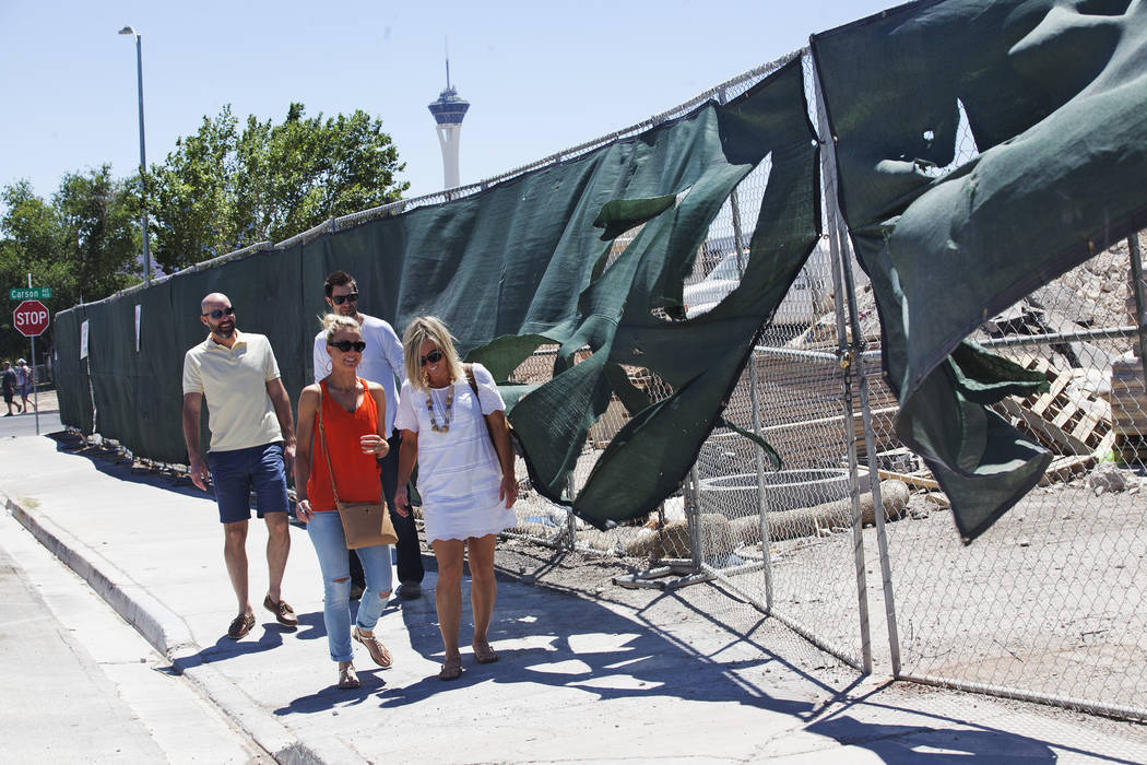 Pedestrians walk past a blowing tarp from construction on Sunday, June 11, 2017, in Downtown Las Vegas. Rachel Aston Las Vegas Review-Journal @rookie__rae