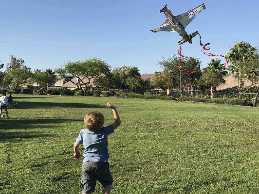 Brendon Carvalho, 4, of Las Vegas, plays with an airplane kite at Arbors Park on Sunday, June 11, 2017. Keith Rogers Las Vegas Review-Journal