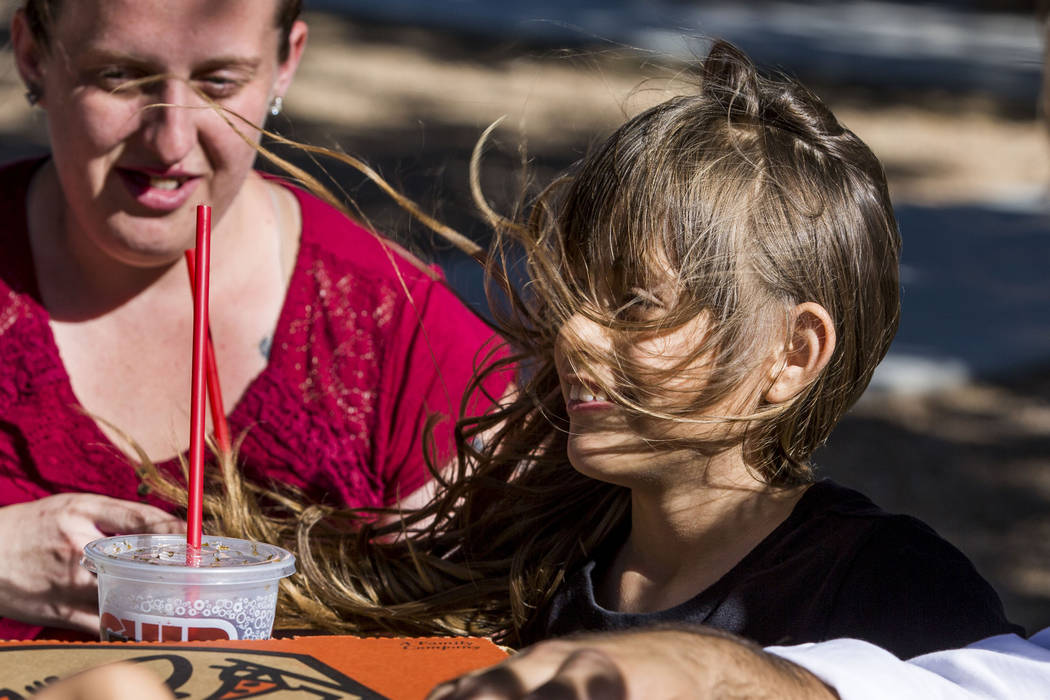 The wind blows eight-year-old Amari Hernandez's hair as she hangs out with Shendra Paprick, left, and other family and friends at Lorenzi Park on Sunday, June 11, 2017.  Patrick Connolly Las Vegas ...