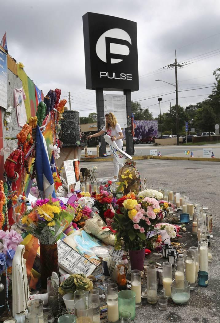 Pulse nightclub owner Barbara Poma tends to the memorial in front of her nightclub Saturday, June 10, 2017, in Orlando, Fla. (Joe Burbank/Orlando Sentinel via AP)