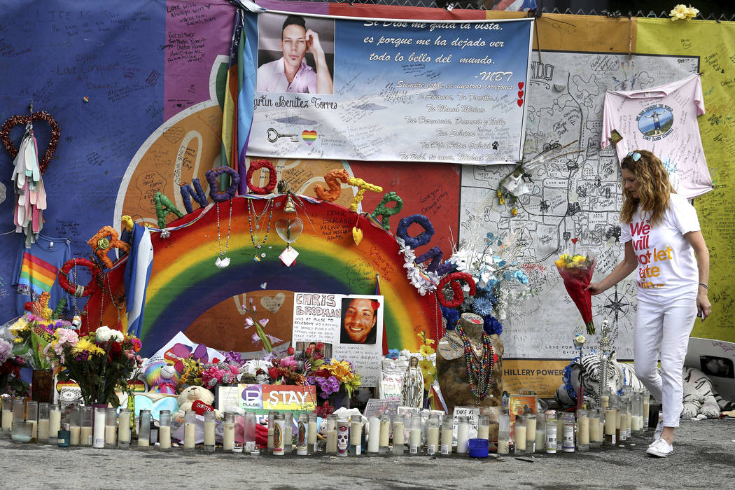 Pulse nightclub owner Barbara Poma tends to the memorial in front of her club Saturday, June 10, 2017, in Orlando, Fla. Many events are being held across central Florida to commemorate the one-yea ...