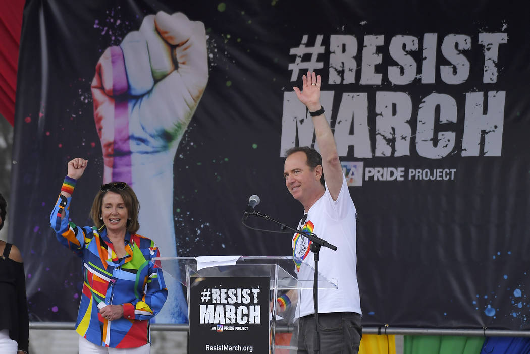 Rep. Adam Schiff, right, D-Calif., ranking member of the House Intelligence Committee, and House Minority Leader Nancy Pelosi, D-Calif., speak during the Los Angeles LGBTQ #ResistMarch, Sunday, Ju ...