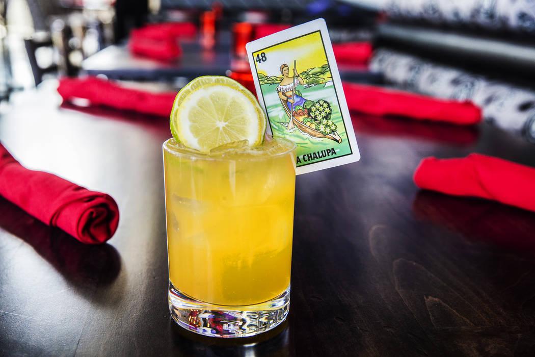 The El Cazo, with Mt. Gay rum, Cointreau Noir, fresh sour, grapefruit juice, orange juice and seasonal fruit at Bandito Latin Kitchen & Cantina on Thursday, June 8, 2017, in Las Vegas. Benjami ...