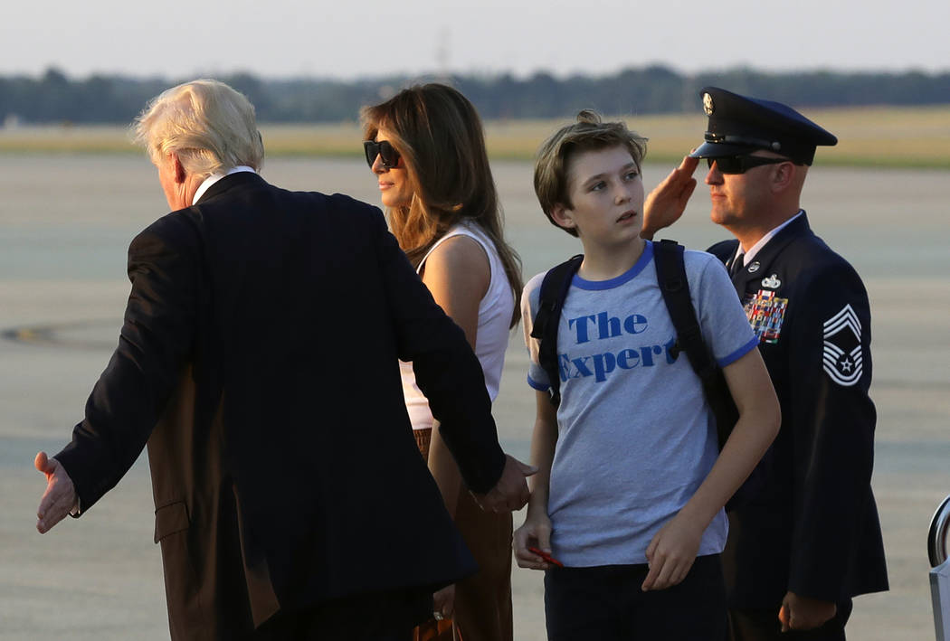 Barron Trump, second from right, son of President Donald Trump, looks back at Air Force One after arriving with the president and first lady Melania Trump at Andrews Air Force Base, Md., Sunday, J ...