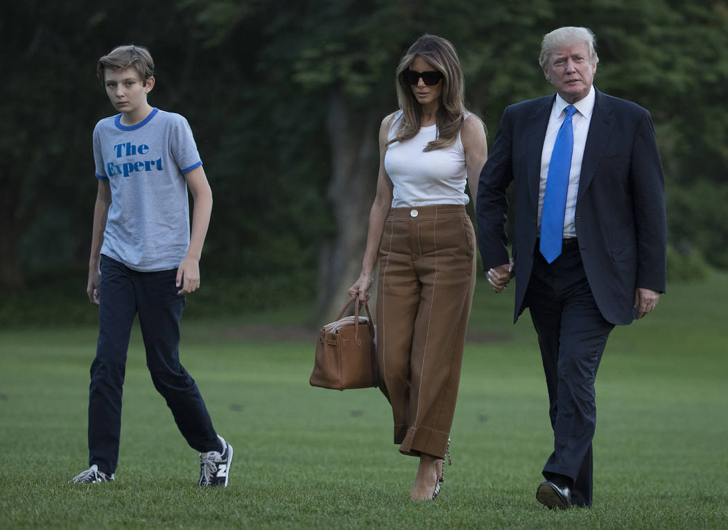 President Donald Trump, first lady Melania Trump, and their son and Barron Trump walk from Marine One across the South Lawn to the White House in Washington, Sunday, June 11, 2017, as they return  ...