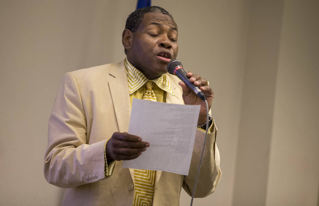 State Director of National Juneteenth Foundation Gary Teeluv Williams sings the black national anthem before the start of a Juneteenth culture and history lecture at the West Las Vegas Library on  ...