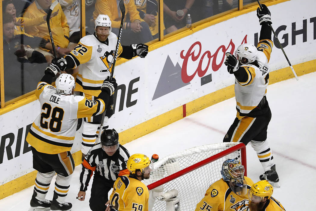 Pittsburgh Penguins' Patric Hornqvist (72), of Sweden,celebrates with Ian Cole (28) after scoring a goal against the Nashville Predators during the third period of Game 6 of the NHL hockey Stanley ...
