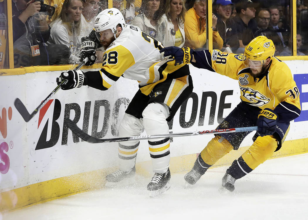 Nashville Predators' Viktor Arvidsson (38), of Sweden, checks Pittsburgh Penguins' Ian Cole (28) into the boards during the third period of Game 6 of the NHL hockey Stanley Cup Final, Sunday, June ...