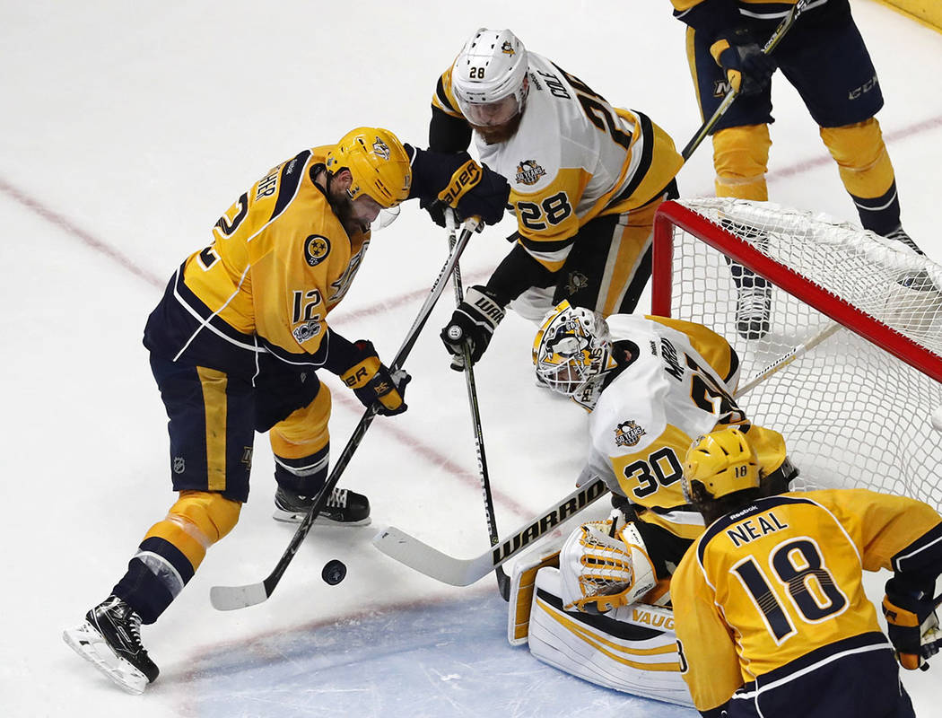 Pittsburgh Penguins' Matt Murray (30) and Ian Cole (28) block a shot by Nashville Predators' Mike Fisher during the third period of Game 6 of the NHL hockey Stanley Cup Final, Sunday, June 11, 201 ...