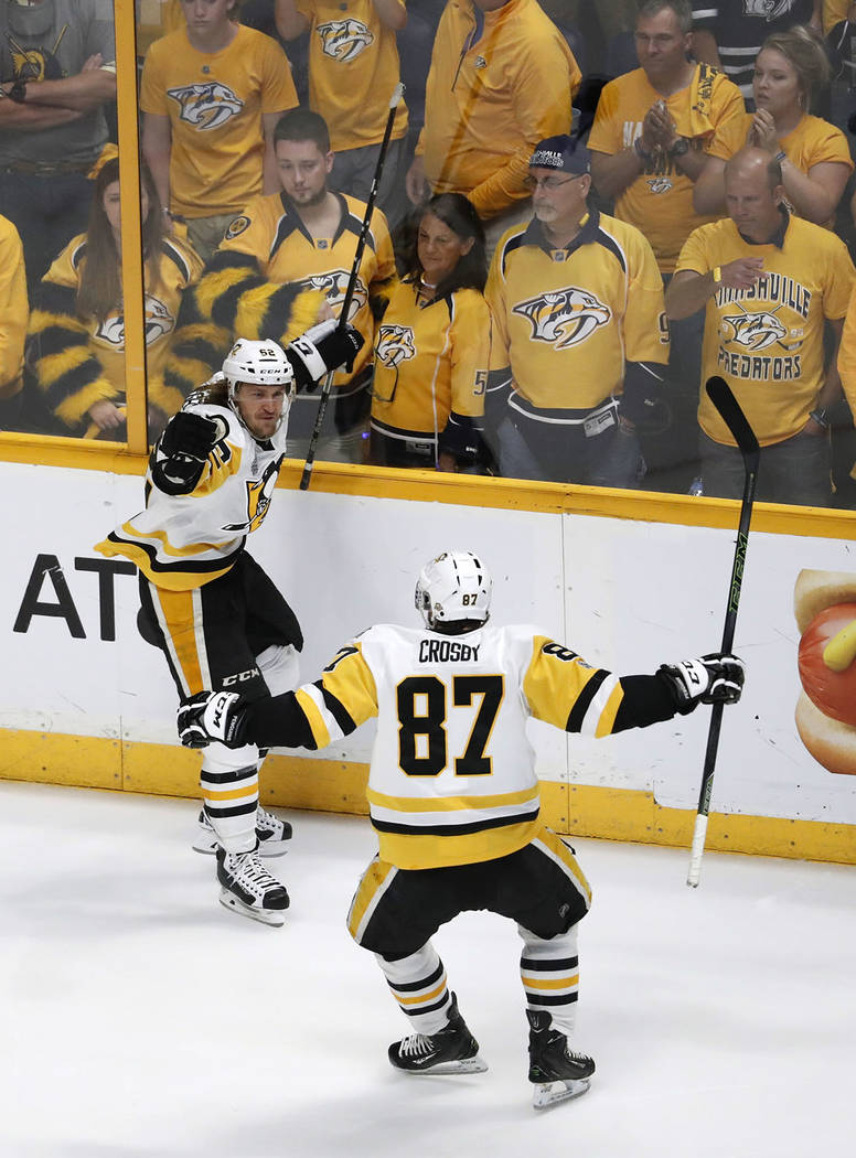 Pittsburgh Penguins' Carl Hagelin (62), of Sweden, celebrates with Sidney Crosby (87) after scoring a goal against the Nashville Predators during the third period of Game 6 of the NHL hockey Stanl ...