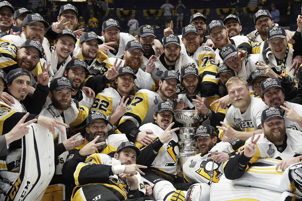 Pittsburgh Penguins players celebrate after defeating the Nashville Predators 2-0 in Game 6 of the NHL hockey Stanley Cup Final, Sunday, June 11, 2017, in Nashville, Tenn. (AP Photo/Mark Humphrey)