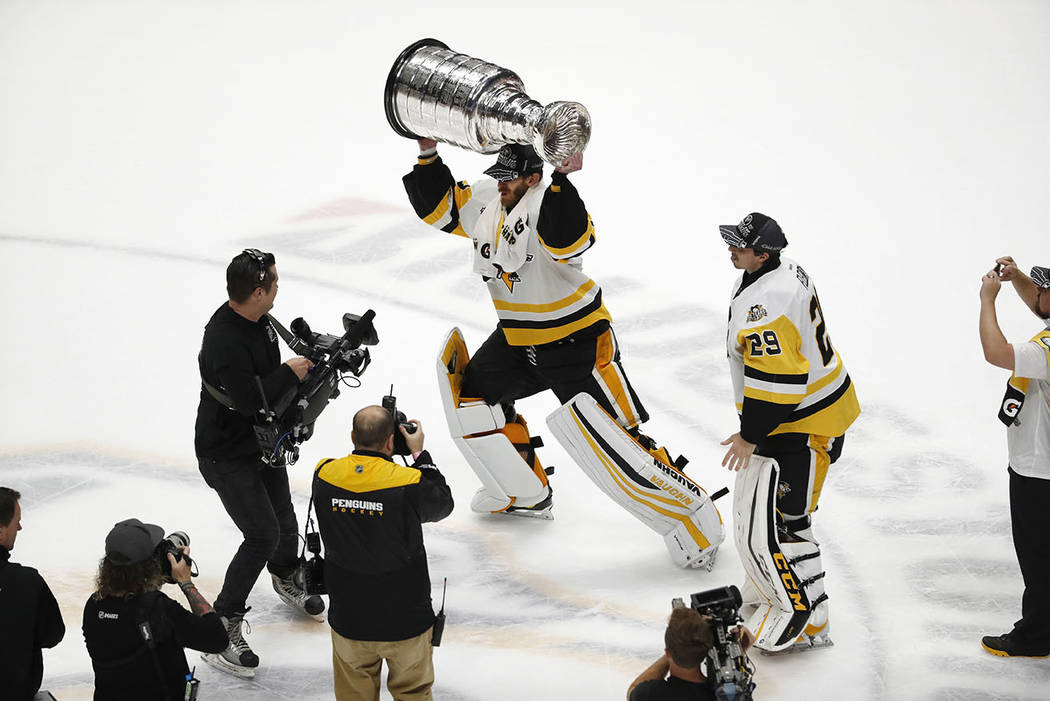Pittsburgh Penguins goalie Matt Murray hoists the Stanley Cup after defeating the Nashville Predators 2-0 in Game 6 of the NHL hockey Stanley Cup Final, Sunday, June 11, 2017, in Nashville, Tenn.  ...
