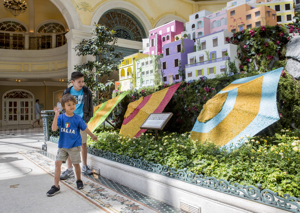 Matthew Reginaldo, 12, and West Tucker, 4, both from San Diego, visit the new Italian-inspired display at Bellagio's Conservatory & Botanical Gardens on Monday, June 12, 2017.  Patrick Connoll ...