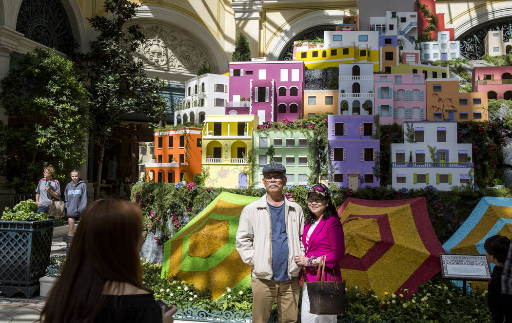 Rue Duong, right, and Hong Tran of Anaheim, Calif. stand together for a photo during the opening of the new Italian-inspired display at Bellagio's Conservatory & Botanical Gardens on Monday, J ...