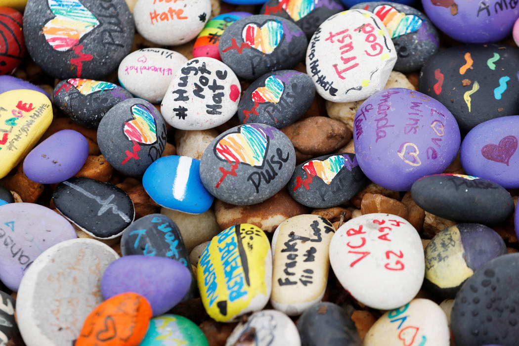 Stones with messages for the victims and survivors are piled outside the Pulse Nightclub on the one-year anniversary of the shooting, in Orlando, Florida. (Scott Audette/Reuters)
