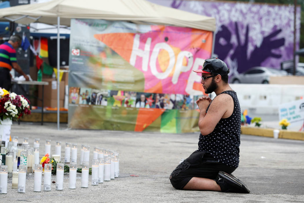Jose Ramirez, a survivor of the Pulse nightclub shooting, reacts at the memorial outside the club on the one-year anniversary of the shooting, in Orlando, Florida. (Scott Audette/Reuters)