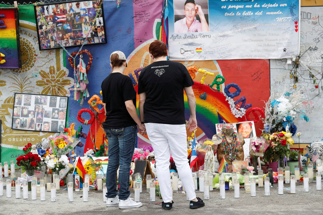 Guests visit the memorial outside the Pulse Nightclub on the one-year anniversary of the shooting, in Orlando, Florida. (Scott Audette/Reuters)