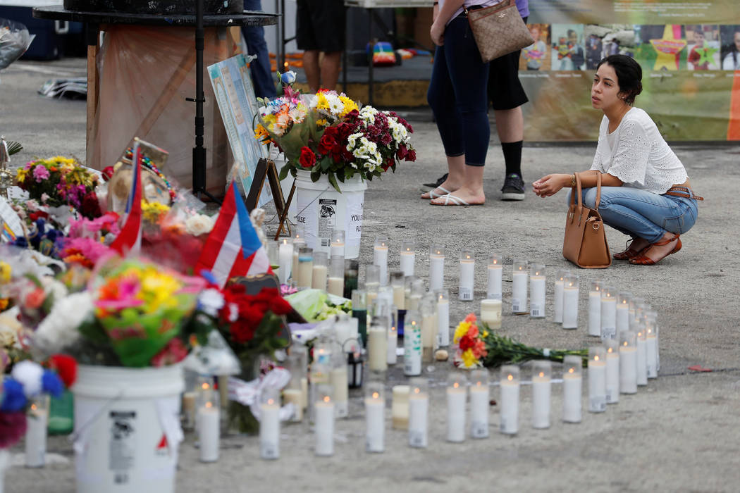 A guest visits the memorial outside the Pulse Nightclub on the one-year anniversary of the shooting, in Orlando, Florida. (Scott Audette/Reuters)