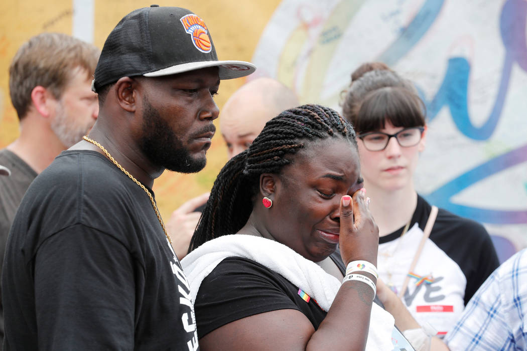 Guests react to the memorial outside the Pulse Nightclub on the one-year anniversary of the shooting in Orlando, Florida, U.S., June 12, 2017. (Scott Audette/Reuters)