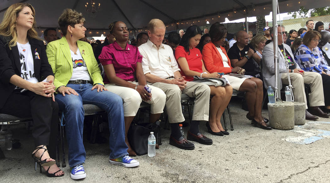 Dignitaries attend a public remembrance ceremony Monday, June 12, 2017, at the Pulse nightclub in Orlando, Fla., in honor of the 49 people who lost their lives in the shooting one year ago. (Joe B ...