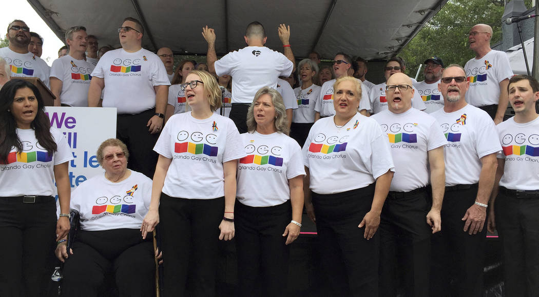 The Orlando Gay Chorus perform at a public remembrance ceremony Monday, June 12, 2017, at Pulse nightclub in Orlando, Fla., in honor of the 49 people who lost their lives in the shooting one year  ...