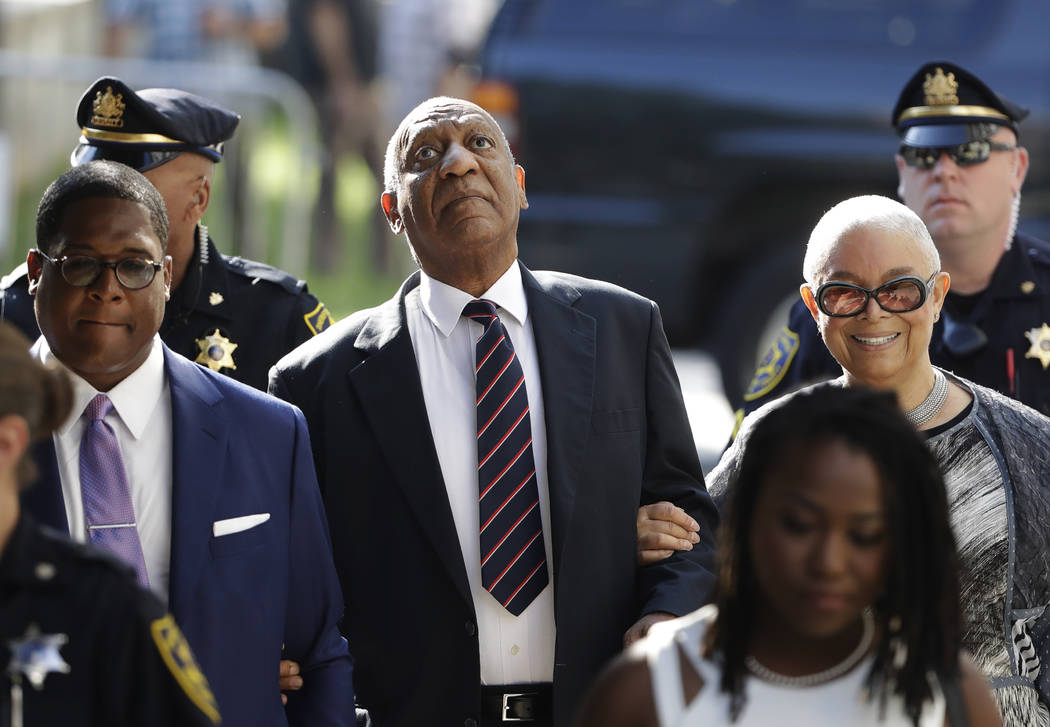 Bill Cosby arrives for his sexual assault trial with his wife, Camille Cosby, right, at the Montgomery County Courthouse in Norristown, Pa., Monday, June 12, 2017. (Matt Rourke/AP)