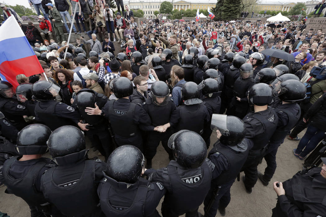 Police form a human chain during anti-corruption rally in St. Petersburg, Russia, Monday, June 12, 2017. Riot police in St. Petersburg have begun detaining demonstrators in an unsanctioned opposit ...