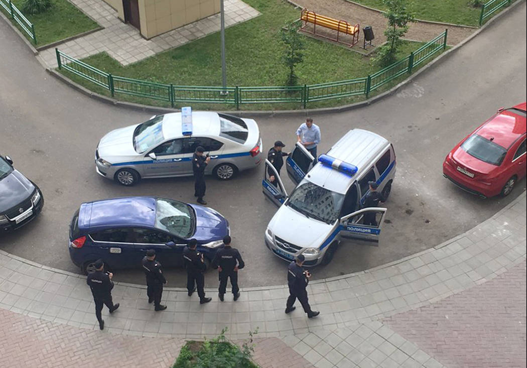 Alexei Navalny, blue shirt, is detained by police outside his apartment in Moscow, Monday, June 12, 2017. Russian opposition leader Alexei Navalny, aiming to repeat the nationwide protests that ra ...