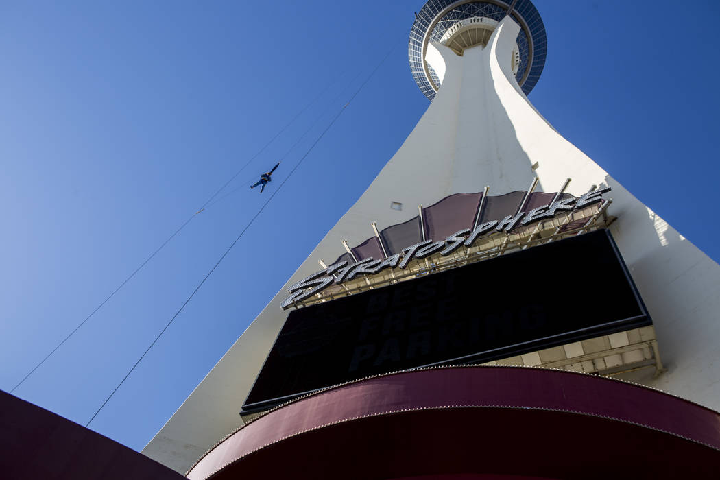 A thrill seeker falls to the earth while riding SkyJump at the Stratosphere on Monday, June 12, 2017. Golden Entertainment, operators of the PT's Pubs chain is acquiring a company that owns four N ...