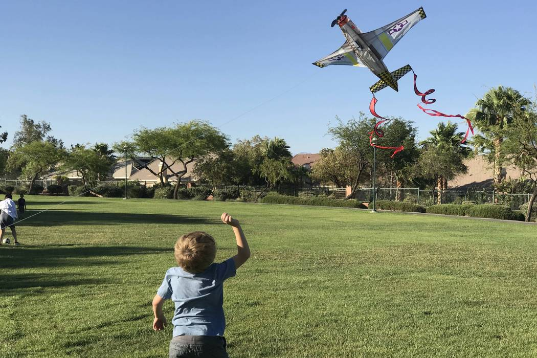 Brendon Carvalho, 4, of Las Vegas, plays with an airplane kite at Arbors Park on Sunday, June 11, 2017. (Keith Rogers/Las Vegas Review-Journal)