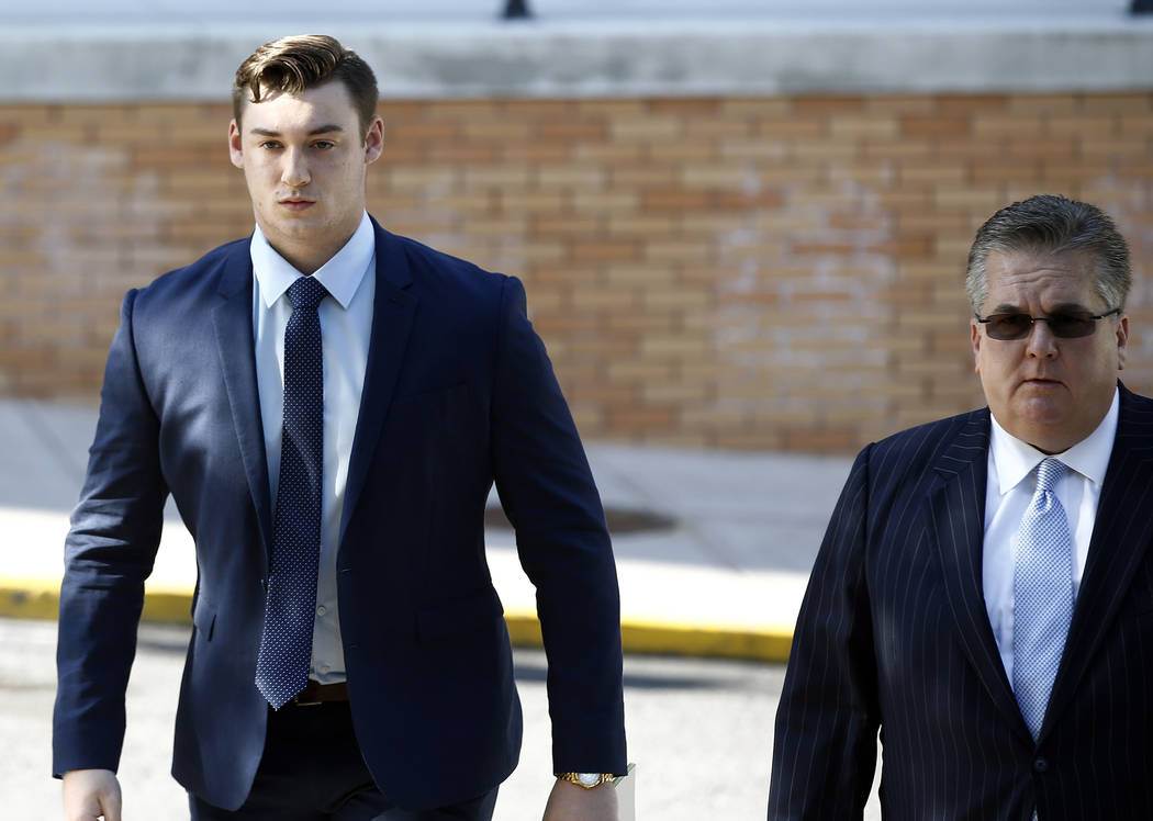 Joseph Ems, left, arrives for his preliminary hearing on charges related to the hazing death of Timothy Piazza at Penn State's Beta Theta Pi fraternity at the Centre County Courthouse in Bellefont ...