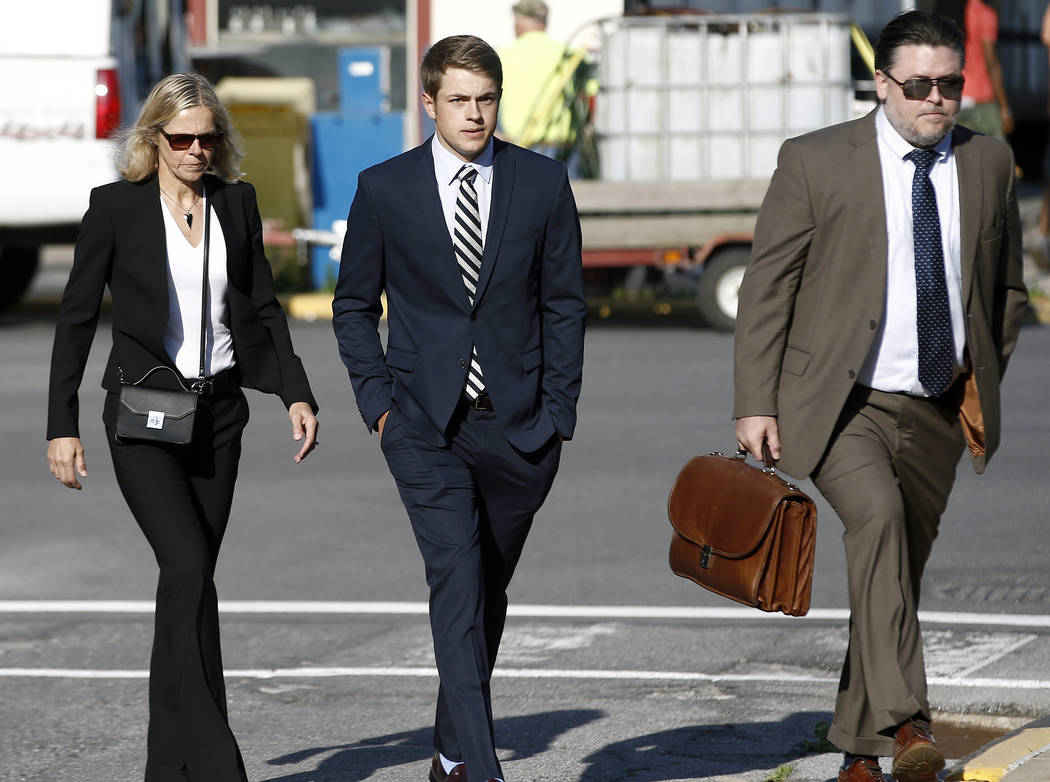 Lars Kenyon, center, arrives for his preliminary hearing on charges related to the hazing death of Timothy Piazza at Penn State's Beta Theta Pi fraternity at the Centre County Courthouse in Bellef ...
