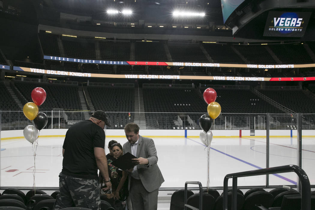 Sam Pointer, a Ticketing and Suites Sales intern, helps customers shop for glass seats at the T-Mobile Arena in Las Vegas, Tuesday, June 13, 2017. Gabriella Angotti-Jones Gabriella Angotti-Jones L ...
