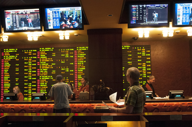People watch ESPN in anticipation of the NFL season at the Golden Nugget Race and Sports Book, Thursday, Sept. 5, 2013, in Las Vegas, Nev. The Golden Nugget will be hosting a handicapping football ...