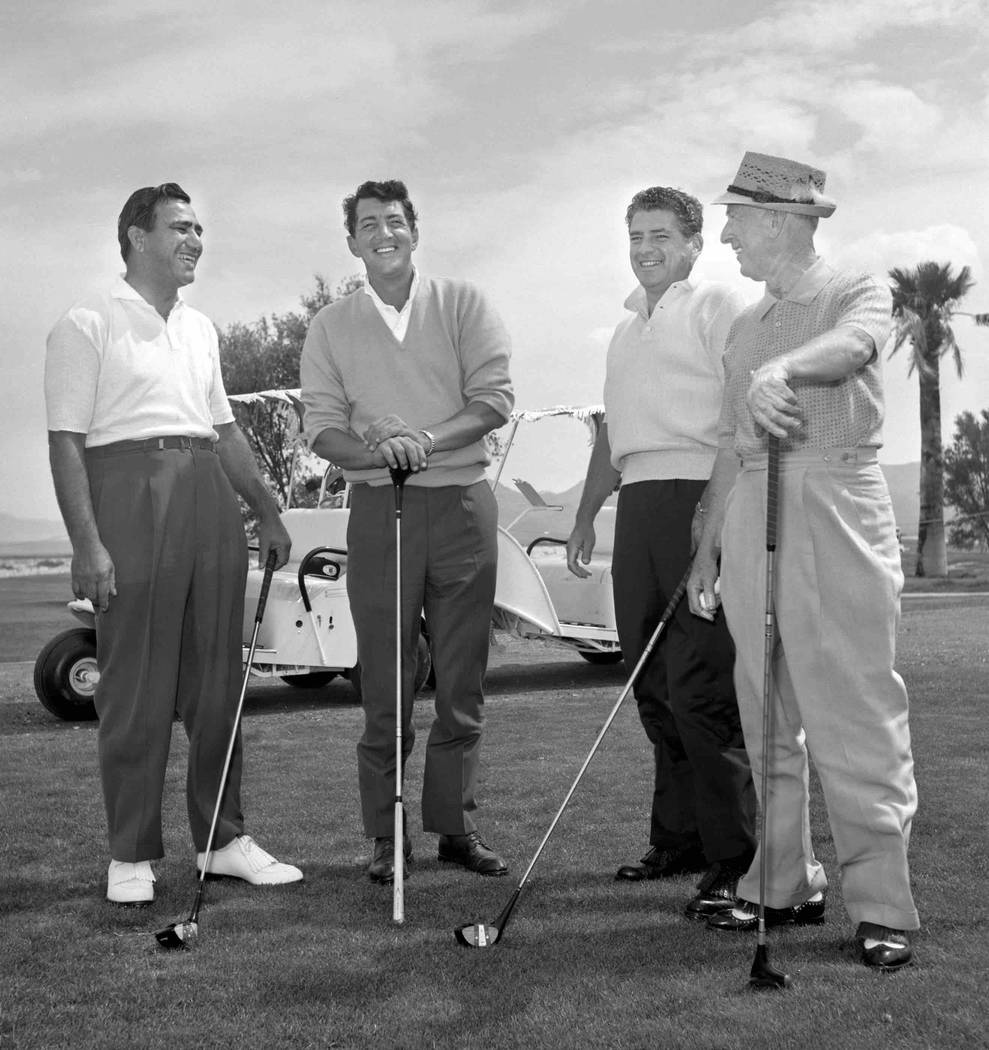 Dean Martin is seen at the Paradise Valley Country Club with Sahara executive Barney Morris, right, and two others April 6, 1961, in Henderson. Paradise Valley Country Club was built by Las Vegas  ...