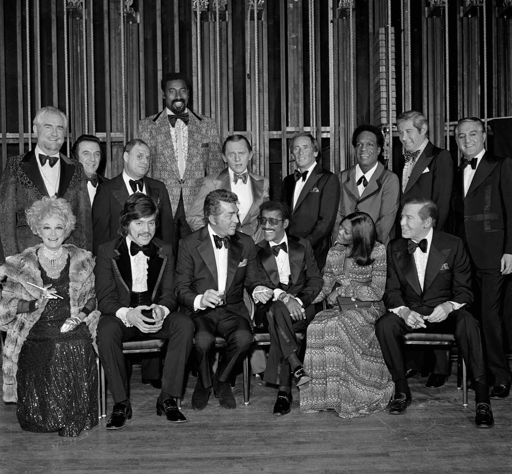 "Dean Martin and participants in a celebrity roast of Sammy Davis Jr. pose for a group photo during the taping of ""The Dean Martin Celebrity Roast"" Dec. 17, 1974 in the Ziegfield Room at the MGM in ..."