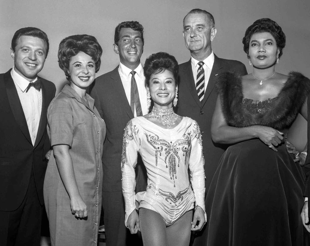 From left, Steve Lawrence, Eydie Gorme, Dean Martin, unknown, Vice President Lyndon Johnson and Pearl Bailey pose for a photo during a rally at the Las Vegas Convention Center Oct. 2, 1961. (Milt  ...